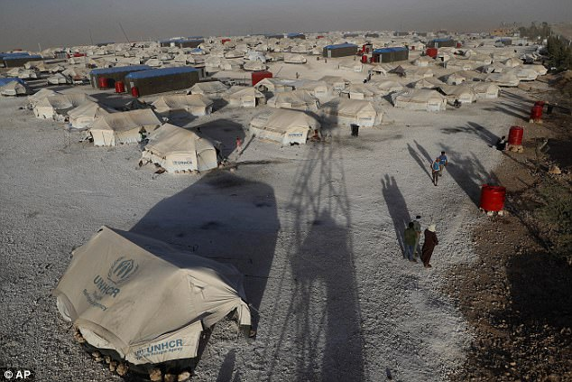 A general view of a refugee camp where Syrian displaced people who fled with their families the battle between U.S.-backed Syrian Democratic Forces and the Islamic State militants from Raqqa and other cities gather, in Ain Issa town, northeast Syria, Wednesday, July 19, 2017