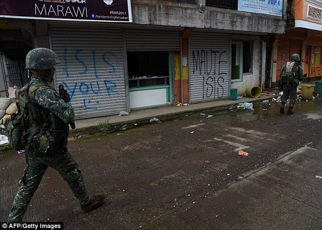 News Corp suspects Filipino families in Marawi (pictured) are being bought by IS for $50 after hundreds of thousands of people have been displaced since May