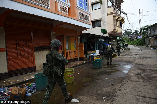 Marawi City (pictured) has been fighting IS-linked militants since May, hundreds dead