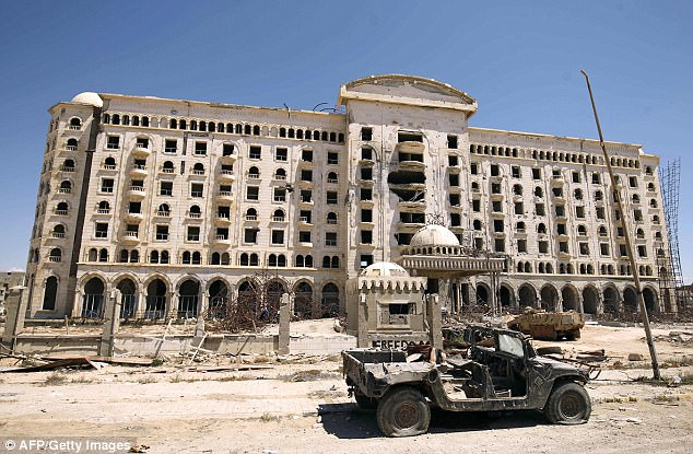 "A picture shows a damaged building in Benghazi's central Akhribish district on July 19, 2017. Libyan military strongman Khalifa Haftar on July 5, 2017, announced the ""total liberation"" of second city Benghazi, which was overrun by jihadists three years ago"