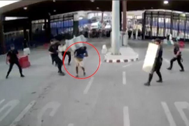 It is understood the attacker (circled) was shouting 'Allahu akbar' or 'God is greatest' as well as other Arabic chants at the time of his rampage