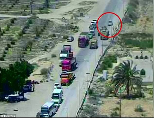 The tank spotted the car (circled) racing towards an army checkpoint in North Sinai and drove head-on to meet them