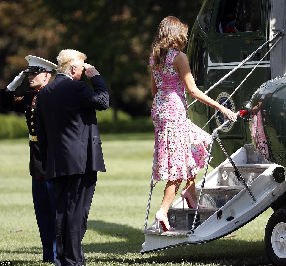 President Trump gave a salute while Melania made her way up the stairs of Marine One