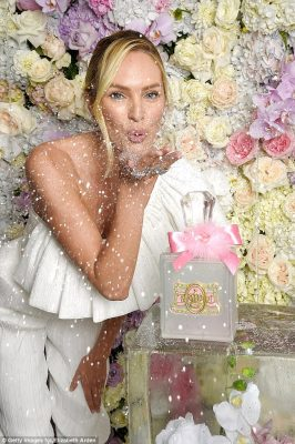 Ice queen: In addition to a frozen floral ice block, crystals swung from the massive purple, pink and white flower wall
