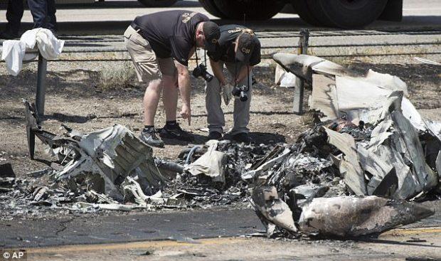 CSI investigators sort through the debris from the plane crash that killed four people in Utah