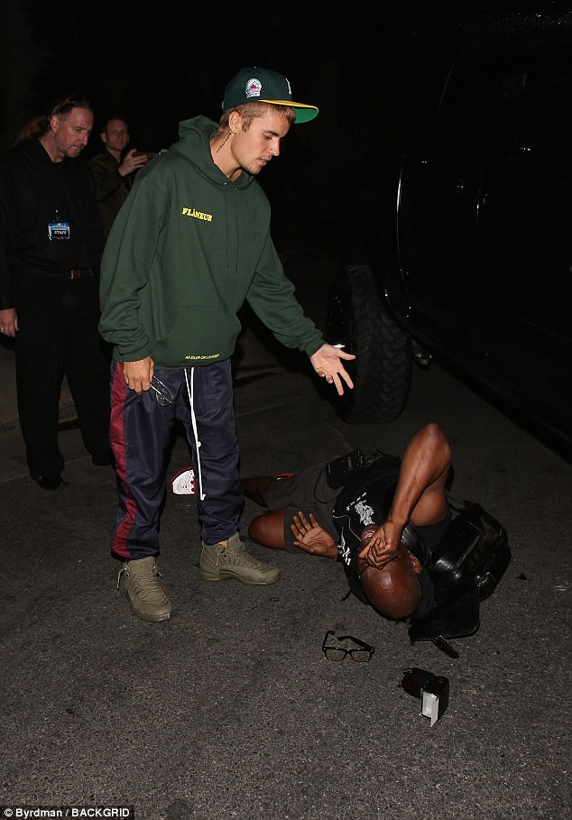 Sorry: Police and paramedics arrived to Hillsong Church in Los Angeles after Justin Bieber is said to have hit a photographer with his truck