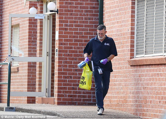 Australian Federal Police on Sunday leaving a property after the dramatic terror raids
