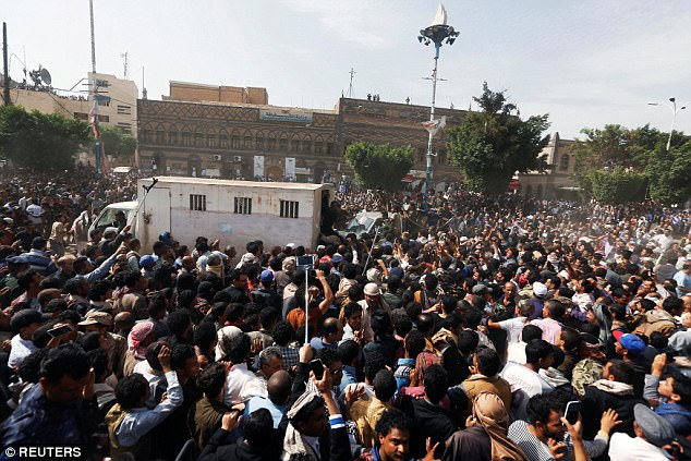 Thousands of people including those carrying cameras on selfie sticks gathered to watch the execution in Sanaa on Monday