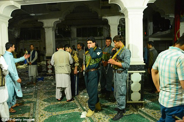 There was no immediate claim of responsibility for the latest attack to hit Afghanistan, which has seen more than 1,700 civilian deaths so far this year. Pictured above,Afghan security personel inspect the site
