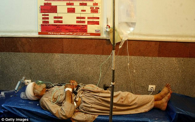 An old man receives medical attention at a local hospital after a suicide bomber attacked the mosque he was praying at