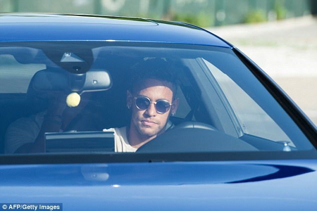 Neymar looked pensive as he arrived for Barcelona training with two friends on Wednesday