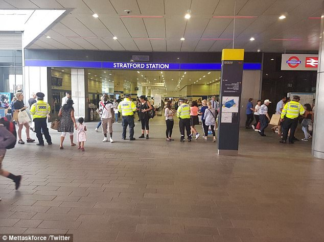 Police speaking to residents at Stratford Station, which has been heavily patrolled for months, after the incident