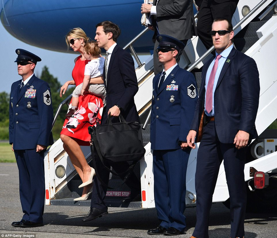 All packed up: Jared held on to a black bag while Ivanka carried their youngest son