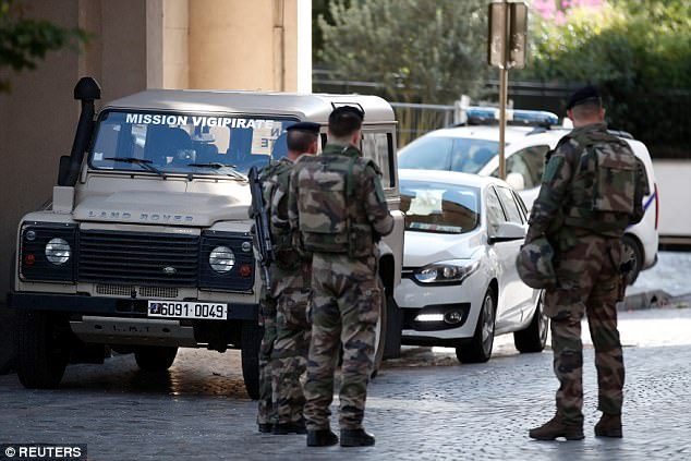 Deliberate: Six soldiers suffered injuries when a BMW slammed into them outside their barracks in a northwestern suburb of Paris, with two of them seriously hurt