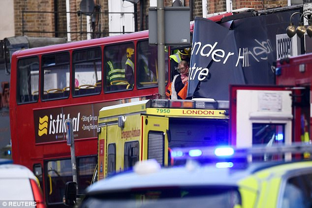 Passengers are rescued having been trapped on the top floor of the bus in South West London