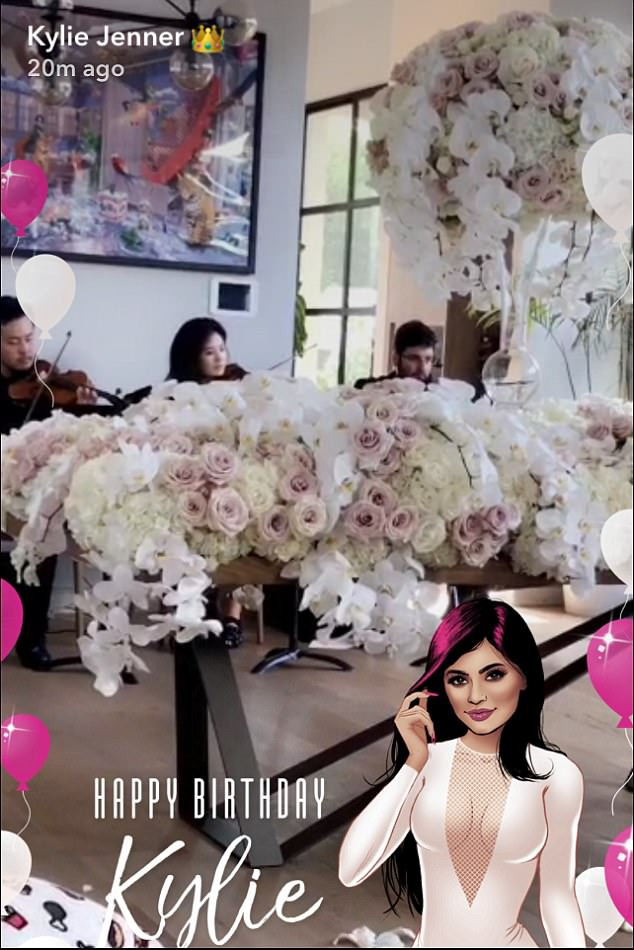 What fun:Hours later, Kylie was serenaded by violists at her house while surrounded by flowers