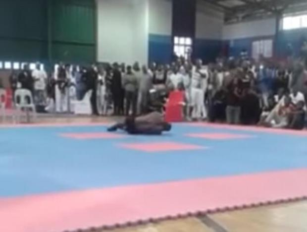 Worried officials rushed to help after he remained motionless on the mat on Saturday