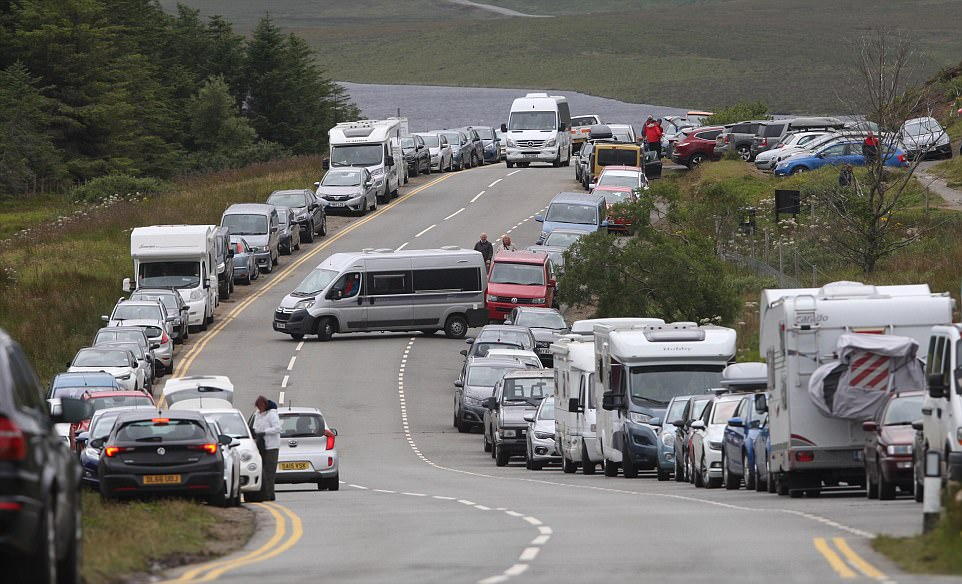 Bumper to bumper: The parking area at the Old man of Stoer on the Isle of Skye where tourists are parking on both sides of the road despite there being yellow lines to block parking there