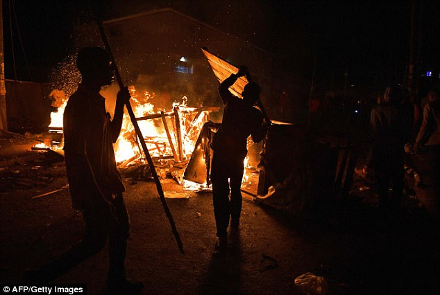 Businesses were burnt and fires set while others celebrated with flags and vuvuzelas