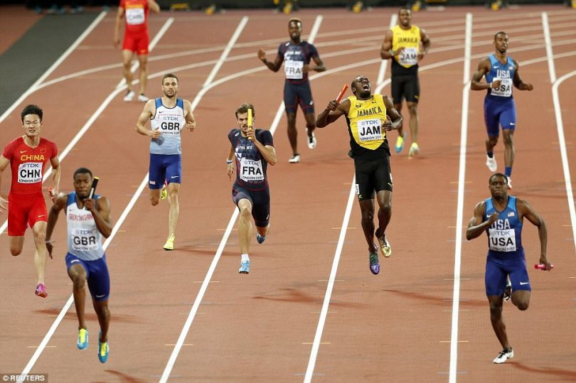Usain Bolt pulled up injured in the 4x100m relay - his final major track race - as Great Britain stormed to victory in a spectacular final