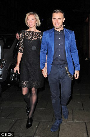 Take That star Gary Barlow(pictured with his wife Dawn Andrews) is at war with developers who want to build dozens of new properties near his Grade II-listed mansion