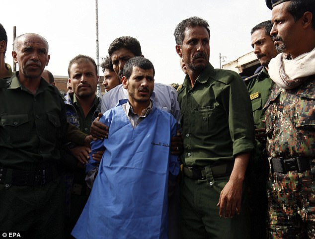 Dead man walking: Yemeni soldiers escort Hussein al-Sakit, 22, to his public execution