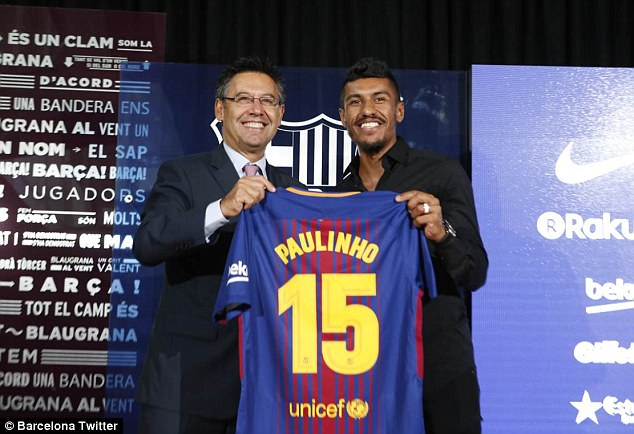 Paulinho is presented with the Barcelona No 15 shirt with club president Josep Maria Bartomeu