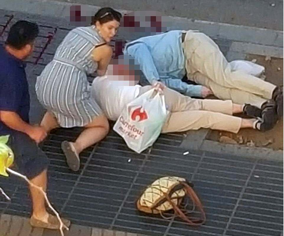 Horrifying images of the aftermath show an elderly couple were among the injured after the van ploughed into pedestrians on the busy Barcelona street