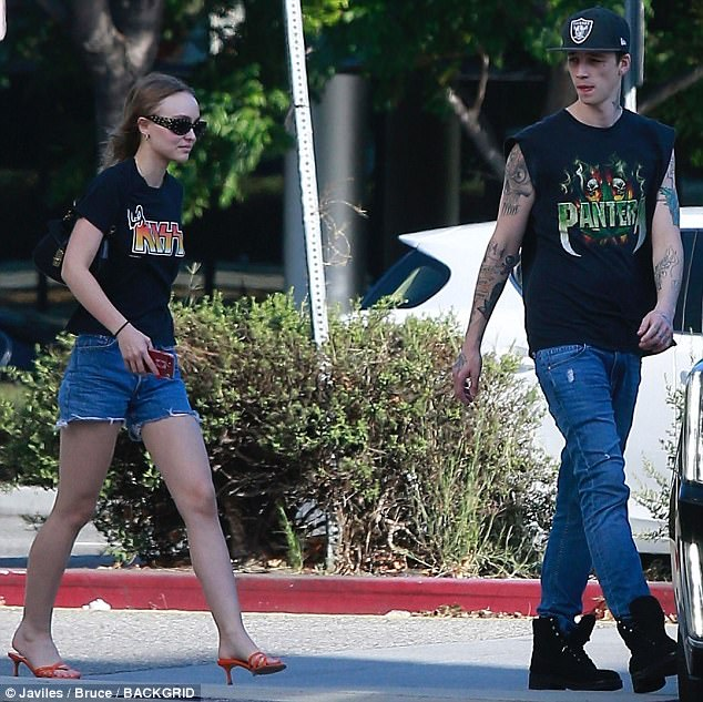 Coordinated couple: Lily-Rose Depp, 18, and boyfriend Ash Stymest, 25, were seen out in LA together on Thursday, clad in similar ensembles