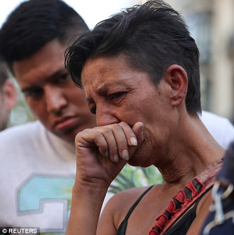 Mourners in Barcelona were in tears and clinging to eachother for support as they surveyed the scene of devastation today