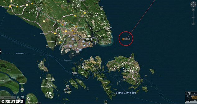 A map shows the location where the Alnic MC merchant vessel came to a halt after a collision with the guided-missile destroyer USS John S. McCain east of Singapore