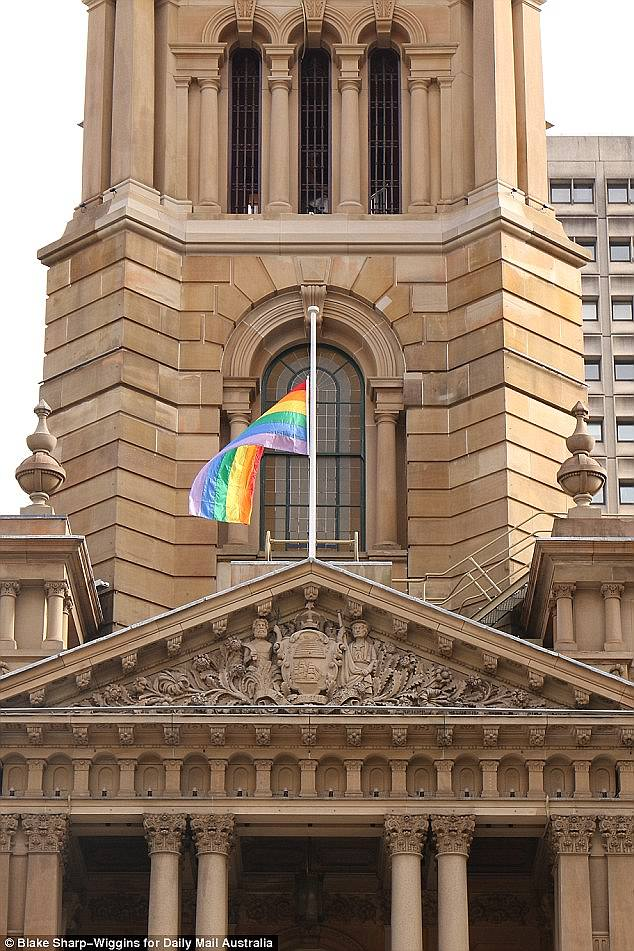 The posters appeared just days after Sydney was hit by similar anti-gay marriage leaflets, posted in letterboxes in the southern Sydney suburb of Hurstville (pictured is the rainbow flag flying over Sydney's Town Hall.