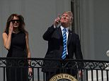 There goes the sun:President Trump had an eclipse viewing party on the terrace of the White House Monday afternoon (President and First lady above on Monday)