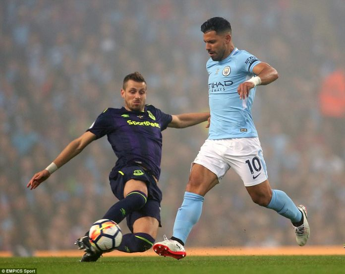 Morgan Schneiderlin slides in late on City striker Sergio Aguero in a bid to prevent a counter from the home side