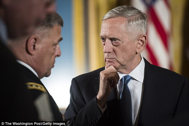 Kicking out: Defense Sec. Jim Mattis (right) must remove anyone who is 'non-deployable' - which includes transgender service members, according to the new guidelines