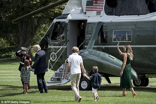 US President Donald Trump  walks with granddaughter Arabella Rose Kushner (2L), son Barron Trump (3R) grandson Joseph Frederick Kushner (2R) and US first lady Melania Trump to Marine One on the South Lawn of the White House