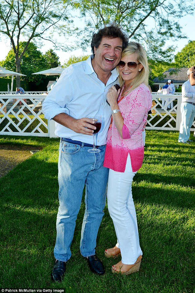 Steven Dym and Loretta Dym are pictured attending the The Sixteenth Annual Midsummer Night Drinks Benefiting God's Love We Deliver at Private Residence on June 18, 2016 in Bridgehampton, NY. Steven is believed to have shot dead his wife and their daughter in an apparent double murder-suicide