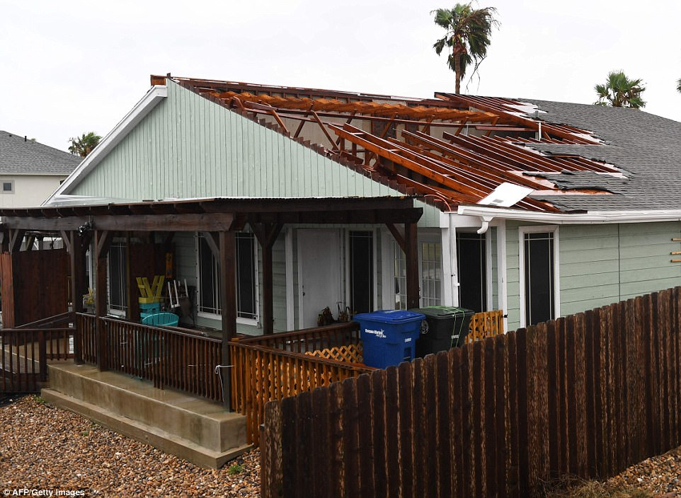 A house suffers roof damage after Hurricane Harvey hit Corpus Christi on Saturday