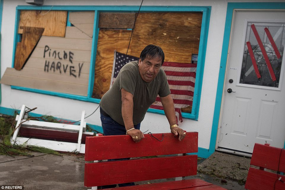 Business owner and resident Carlos Lopez assesses damage from Hurricane Harvey after arriving at his electronics repair shop in Rockport, Texas