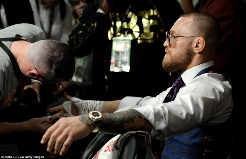 A serious-looking McGregor has his hands wrapped for his super-welterweight boxing match against Mayweather