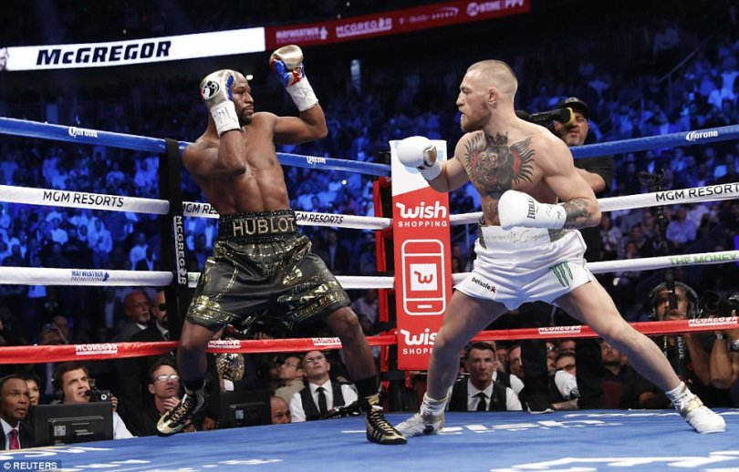 Mayweather, who was undefeated in 49 professional fights prior to this fight, puts his defence up as McGregor eyes a move