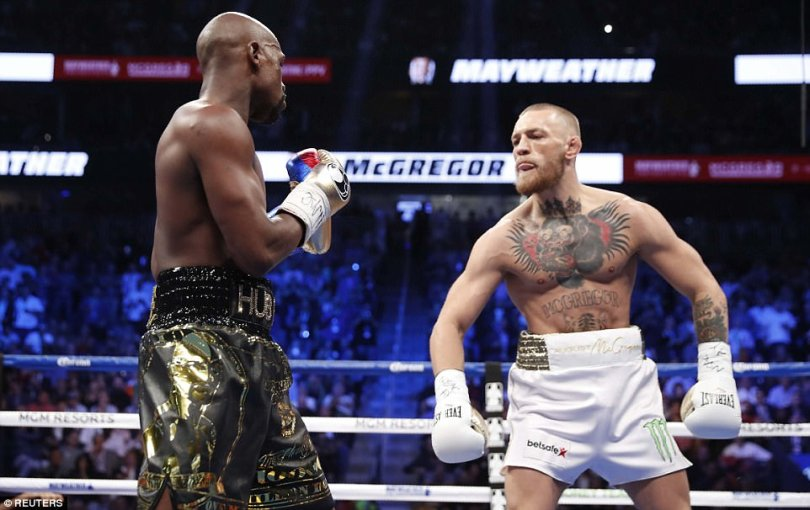 When Mayweather backed away to absorb an assault, Mayweather mocked him,going far as to put his hands behind his back