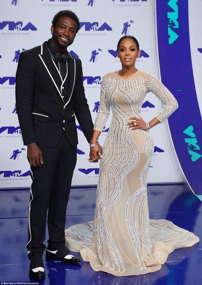 Happy: Rapper Gucci Mane was hand-in-hand withKeyshia Ka'oir
