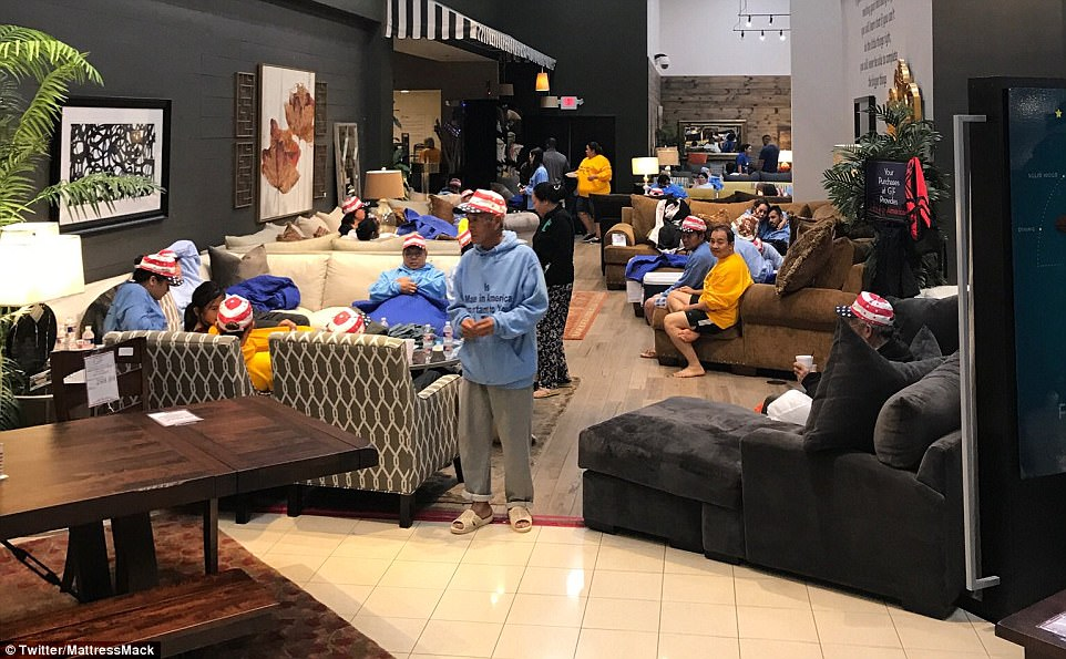 Hundreds of people have taken up refuge inside the Houston furniture store since its owner opened up his doors
