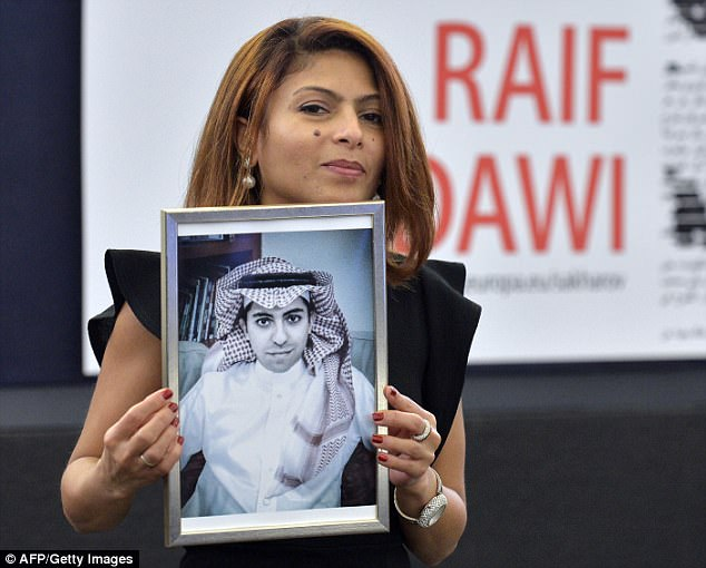 Freedom fighter: Ensaf Haidar holds a picture of her husband Raif Badawi, who was sentenced to 1,000 lashes and a decade in prison in 2015