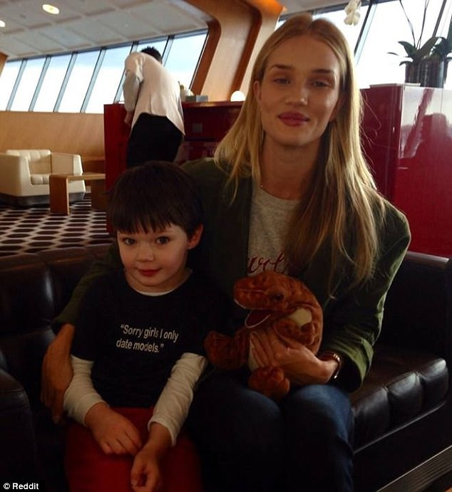 This uploader shared a snap of their cousin posing at an airport with Rosie Huntington Whitely - and his T-Shirt is priceless