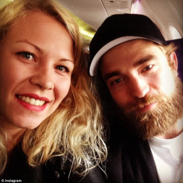 Elsewhere, her ex-boyfriend Robert Pattinson, sporting a full beard, was spotted on a plane and agreed to this quick selfie
