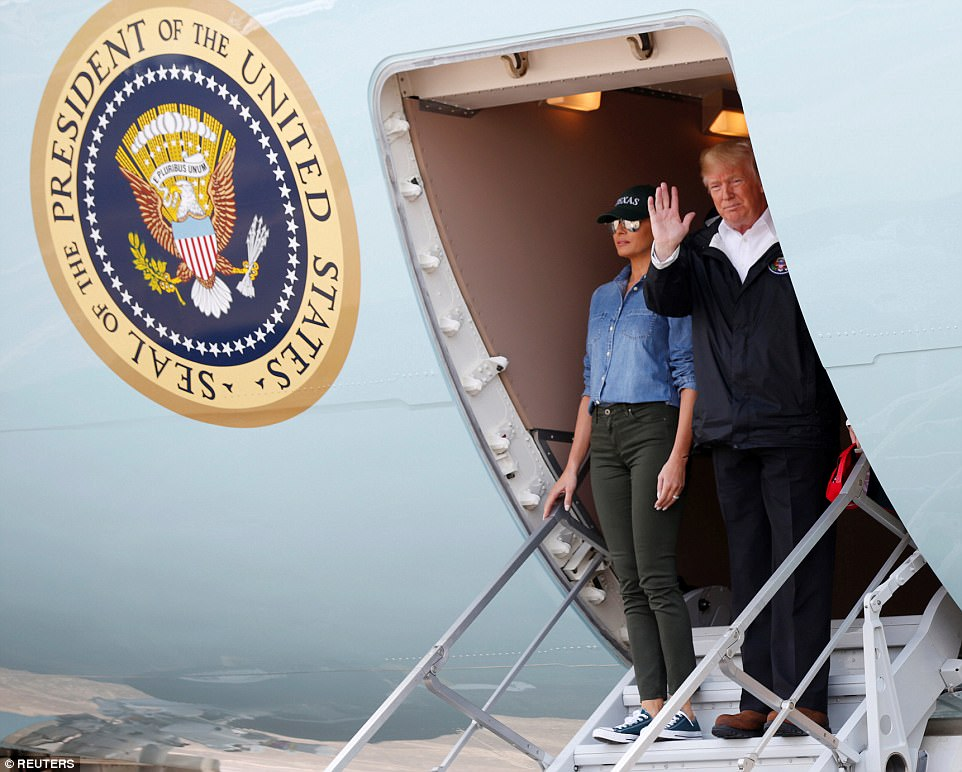 First Lady Melania Trump and President Donald Trump disembark Air Force One after arriving in Houston on Saturday
