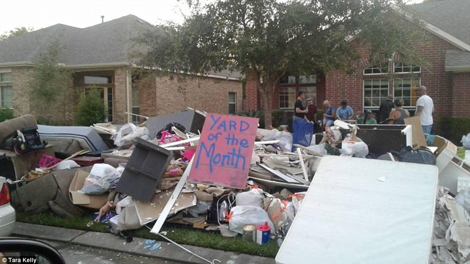 The aftermath of Hurricane Harvey in Dickinson, Texas, on Saturday where residents are now going through the painstaking and devastating chore of tossing out their ruined belongings