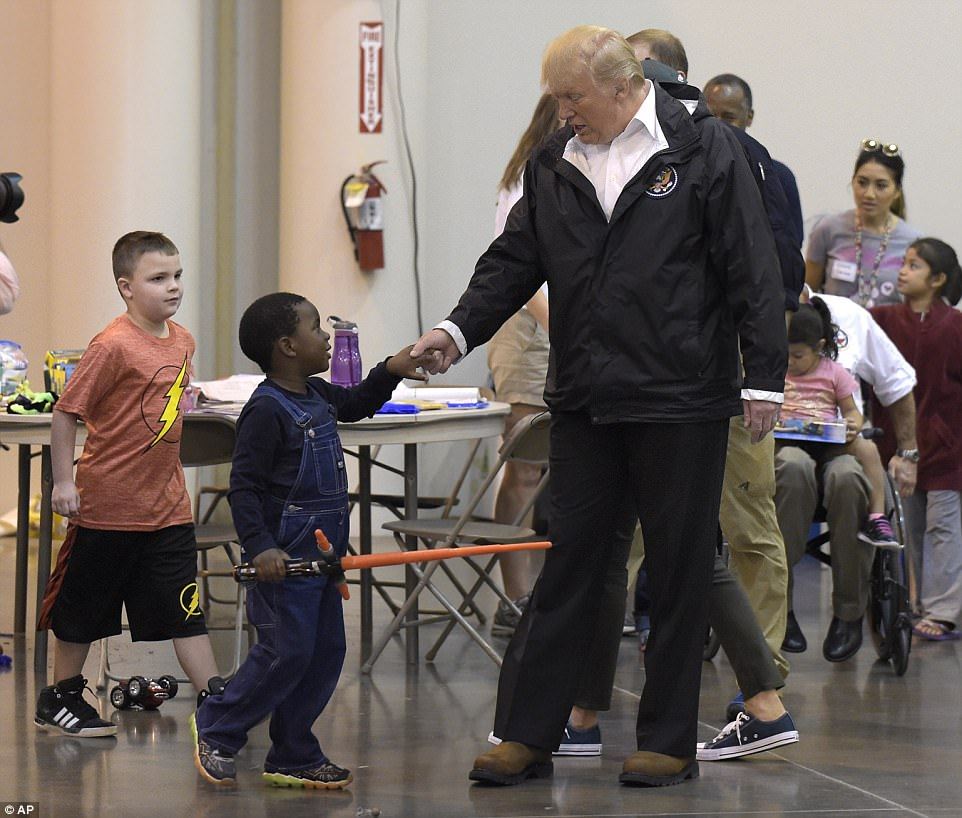 The president was particularly taken with the children taking shelter at the evacuation center, paying special attention to them as he made his way around